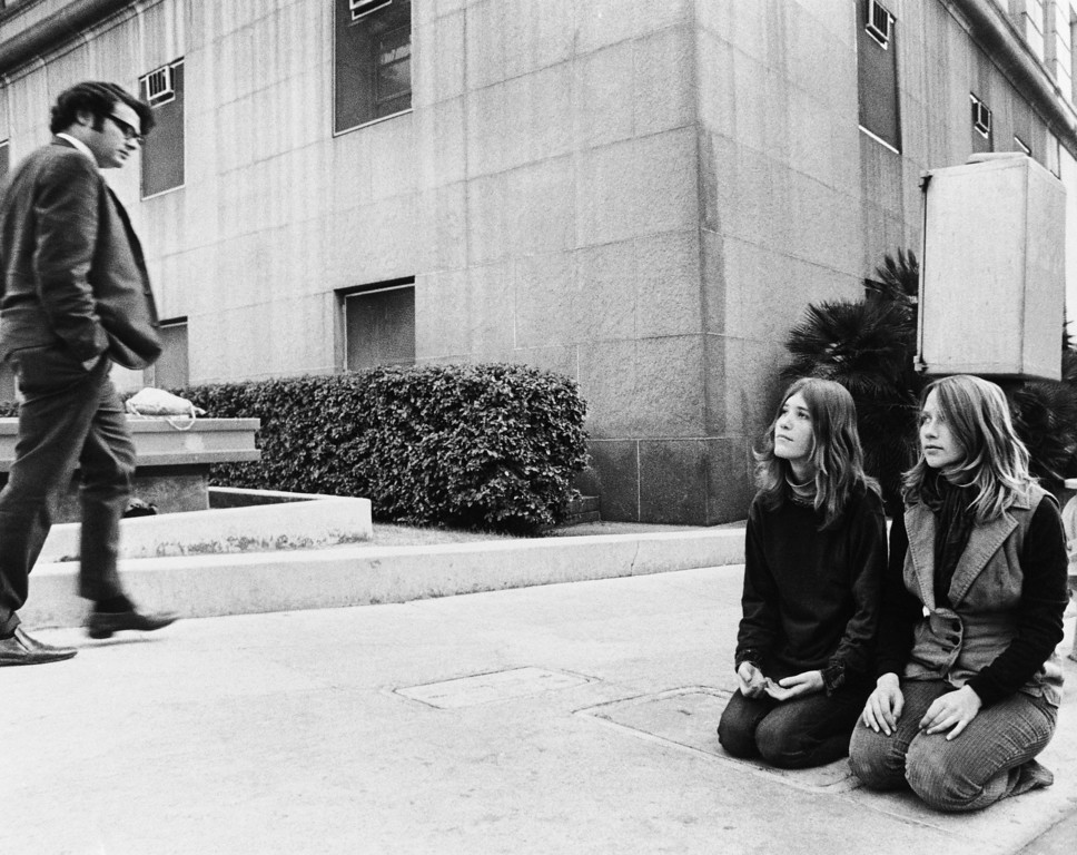 ". Two members of the Charles Manson ""family\"" known as Kitty Lutesinger, left, and Kathy Gillies, kneel on the sidewalk outside the Los Angeles Hall of Justice, Dec. 30, 1970, while the trial of Charles Manson and three women co-defendants on murder charges goes on inside. Members of the Manson cult have maintained almost a continuous vigil for weeks, saying they\'ll wait \""until Charlie is freed.\"" (AP Photo/David F. Smith)"