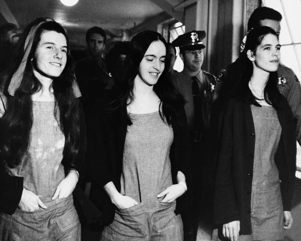 . Three members of Charles Manson\'s hippie style clan leave a Los Angeles Courtroom just after being found guilty, along with Manson of first degree murder, Jan. 25, 1971, Los Angeles, Calif. From left to right are, Patricia Krenwinkel, Susan Atkins and Leslie Van Houten. (AP Photo/Pool)