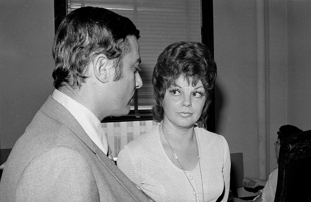 . Mrs. Virginia Graham, 37, talks with her attorney, Robert Steinberg, at the Hall of Justice in Los Angeles, Calif., while waiting to testify as a prosecution witness in the Sharon Tate murder trial, Oct. 9, 1970. She was quoted by the Los Angeles Herald-Examiner in a copyrighted story as saying that defendant Susan Atkins told her, while they were jail cell mates, that the Charles Manson family had a master plan for murder that included killing Elizabeth Taylor, Richard Burton, Frank Sinatra, Tom Jones and Steve McQueen. The defense sought a mistrial on the grounds the story constituted prejudicial publicity, but the motion was denied. (AP Photo)