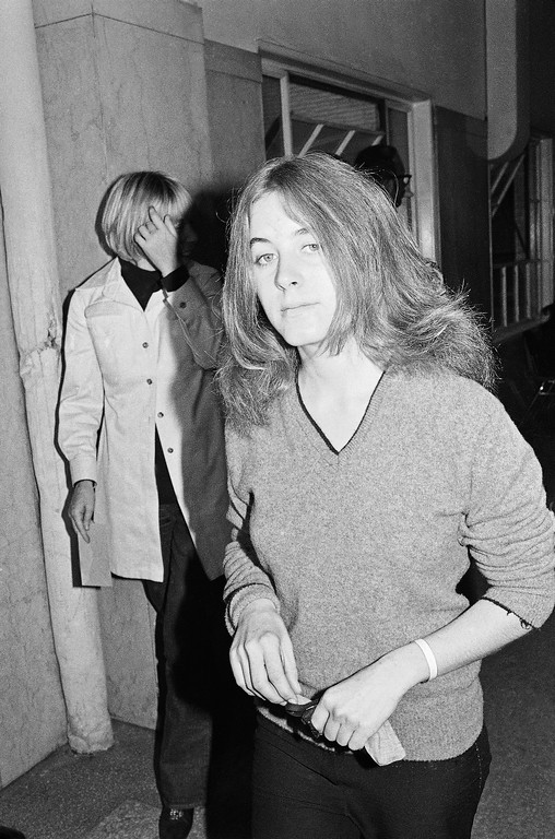 . Nancy Laura Pitman, a 19-year-old friend of Charles Manson, arrives in court in Los Angeles, Dec. 29, 1970 for arraignment after being arrested on Sunday when deputies said she tried to visit Manson while carrying drugs in her purse. She was booked on suspicion of possessing narcotics. Manson is being tried on charges of multiple murders. (AP Photo/Wally Fong)