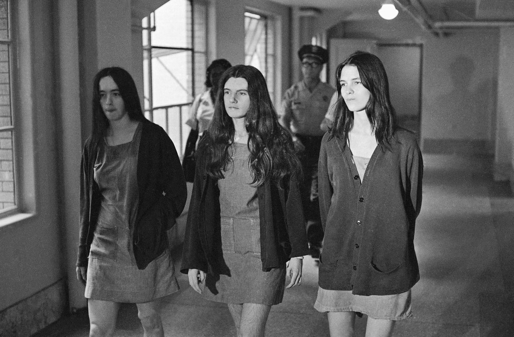 . From left, Susan Atkins, Patricia Krenwinkel, and Leslie Van Houten, defendants in the Sharon Tate murder trial, are shown going to court, Aug. 18, 1970, Los Angeles, Calif. (AP Photo/George Brich)