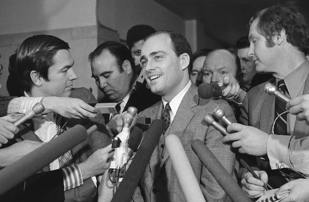 . Vincent Bugliosi (right), chief prosecutor in the trial of Manson and three young women, talk with newsmen outside the courtroom in Los Angeles on Jan. 25, 1971 after the four defendants were found guilty of first degree murder. (AP Photo/WF)