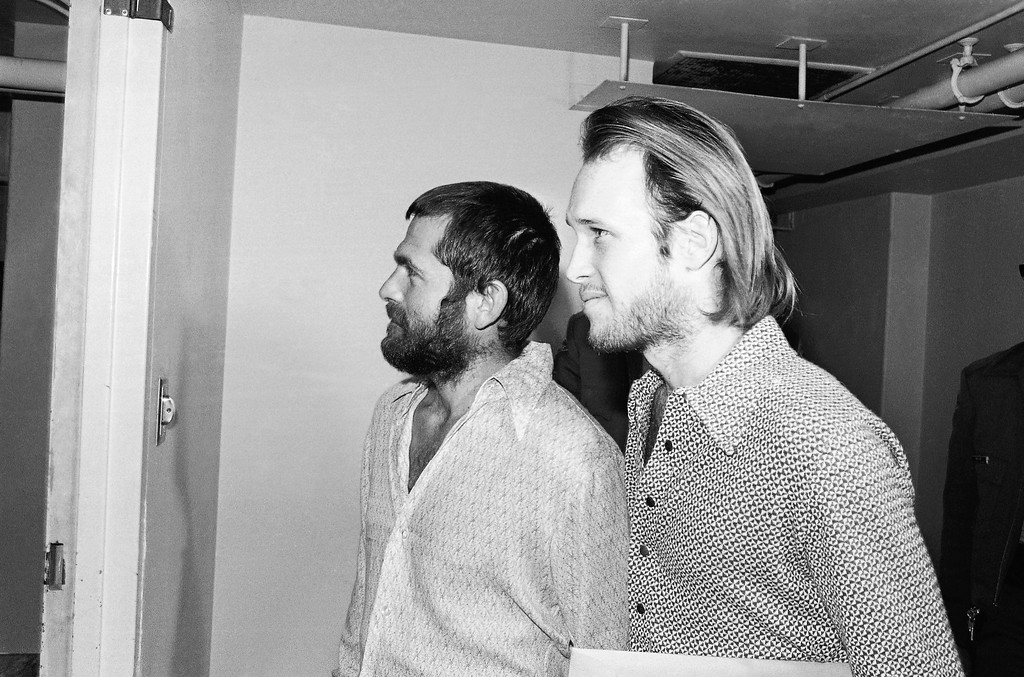 . Two male members of the Charles Manson family, Bruce Davis, left, and Steve Grogan, leave court after a hearing on the appointment of attorneys to represent them, Dec. 22, 1970, Los Angeles, Calif. They are accused of murder, the night charged against Mansion clan members, in the disappearance of Donald J. Shorty Shea in 1969 from an old movie ranch where he was living with the Mansion group. His body never has been found. (AP Photo/Harold Filan)