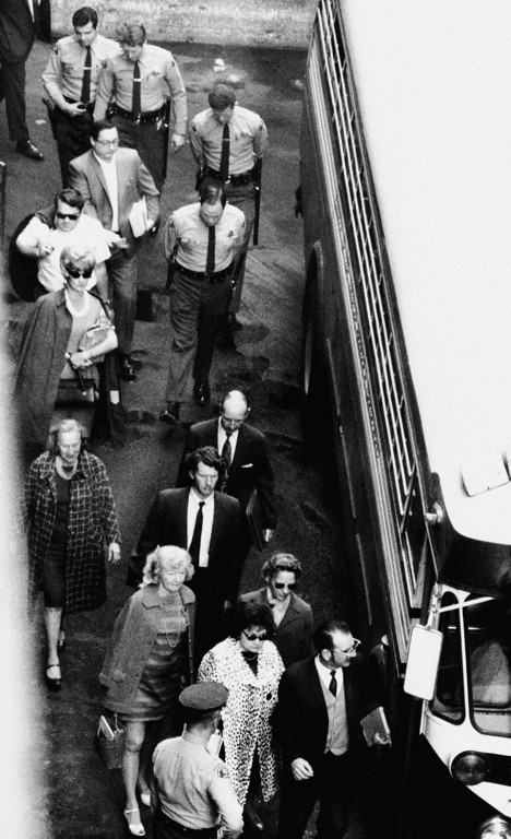. Members of the jury that found Charles Manson and his three female co-defendants guilty of first degree murder, leave the courthouse in Los Angeles, Calif., for their bus amidst heavy guard from sheriff\'s deputies, Jan. 25, 1971. The same jury will now go into the penalty phase of the trial. (AP Photo)