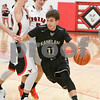 Kaneland Kyle Stuart (11)  drives around Yorkville defenders in the fourth quarter Friday. David Toney – For Shaw Media