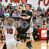 kaneland Rhett Espe (10)  takes a shot in the fourth quarter as Yorkville tries to defend him. David Toney – For Shaw Media
