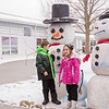 Carrie Garland — The News-Herald <br> The ice was flying during Lake Farmpark's Ice Festival Jan. 28, 2017. Children pose with snowmen at the event.