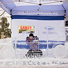 Carrie Garland — The News-Herald <br> The ice was flying during Lake Farmpark's Ice Festival Jan. 28, 2017. A child poses with an ice sculpture at the event.