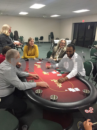 People play a game of poker during Casino Night on Saturday at Hopkins Park in DeKalb. The event raised about $5,000 for The Gracie Center.