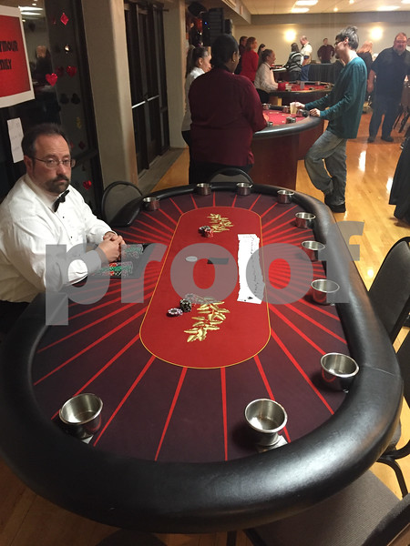 Blackjack dealer Danny Descourouez waits for participants Saturday during Casino Night at The Gracie Center in DeKalb.