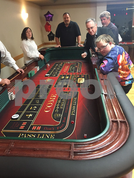 Participants play a game of craps Saturday during Casino Night, hosted by The Gracie Center.