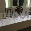 Silent auction prizes line the table at The Church of St. Mary in Sycamore during Hope Haven's annual Sheltering Hope Hoedown on Saturday.