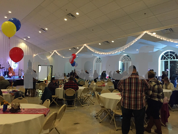 The Church of St. Mary's Memorial Hall lights up for Hope Haven's annual Sheltering Hope Hoedown on Saturday. About $75,000 was raised to support services at the center.