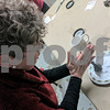 Sally Scott of Sycamore dusts a plate with for fingerprints Thursday during the DeKalb County Sheriff's Office Citizen Academy. Students in the class had the opportunity to dust several items for fingerprints, including in a white van.