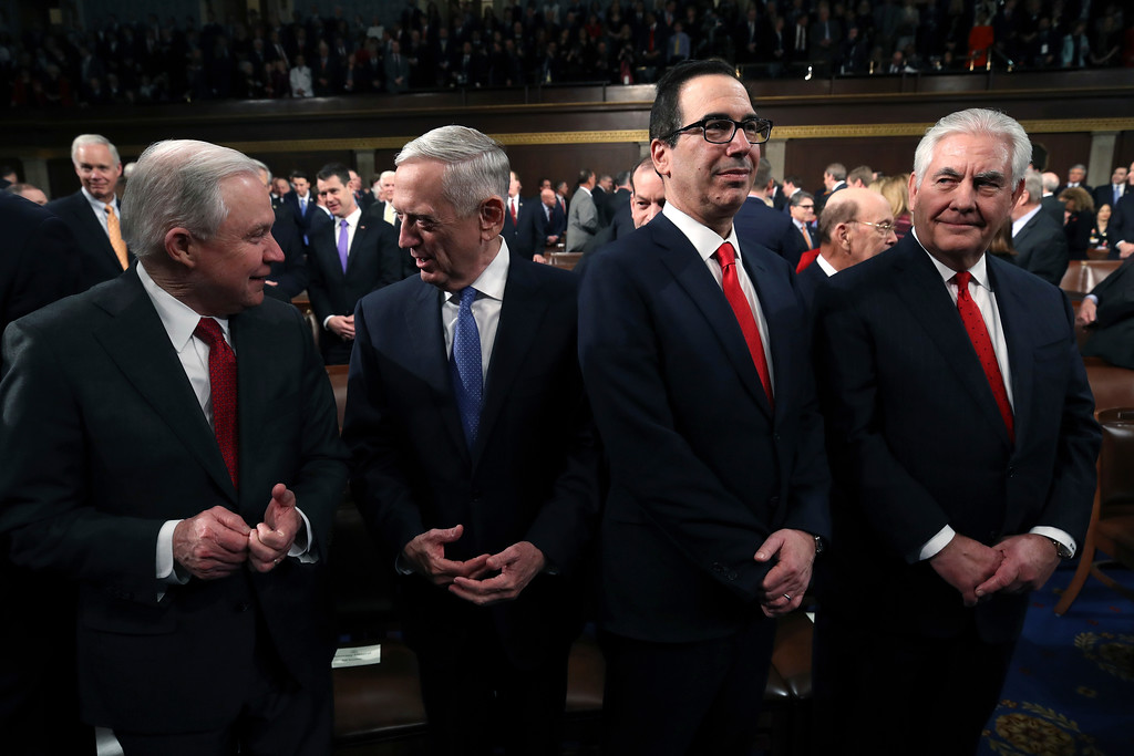 . Attorney General Jeff Sessions, U.S. Secretary of Defense Jim Mattis, Secretary of the Treasury Steven Mnuchin, and Secretary of State Rex Tillerson stand before President Donald Trump gives his State of the Union address in the chamber of the U.S. House of Representatives Tuesday, Jan. 30, 2018, in Washington. (Win McNamee/Pool via AP)