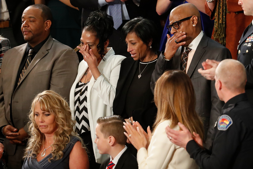 . From top left, Robert Mickens, Elizabeth Alvarado, Evelyn Rodriguez, Freddy Cuevas, parents of two Long Island teenagers who were believed to have been killed by MS-13 gang members, during the State of the Union address to a joint session of Congress on Capitol Hill in Washington, Tuesday, Jan. 30, 2018. (AP Photo/Pablo Martinez Monsivais)