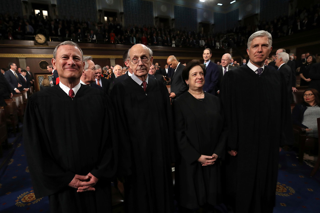 . U.S. Supreme Court Chief Justice John G. Roberts, U.S. Supreme Court Associate Justice Stephen G. Breyer, U.S. Supreme Court Associate Justice Elena Kagan, U.S. Supreme Court Associate Justice Neil M. Gorsuch arrives for the State of the Union address in the chamber of the U.S. House of Representatives Tuesday, Jan. 30, 2018 in Washington. (Win McNamee/Pool via AP)