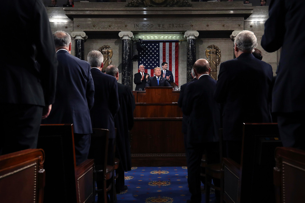 . President Donald Trump delivers his first State of the Union address in the House chamber of the U.S. Capitol to a joint session of Congress Tuesday, Jan. 30, 2018 in Washington. (Win McNamee/Pool via AP)