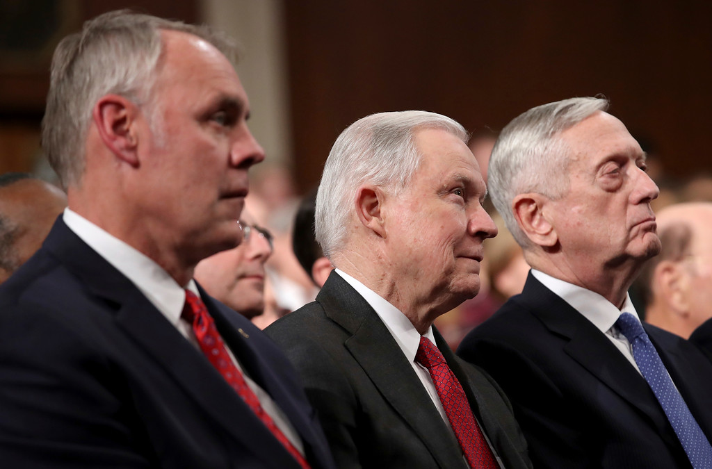. From left, Secretary of the Interior Ryan Zinke,  Attorney General Jeff Sessions, and U.S. Secretary of Defense Jim Mattis watch Donald Trump deliver the State of the Union address in the chamber of the U.S. House of Representatives Tuesday, Jan. 30, 2018 in Washington. (Win McNamee/Pool via AP)