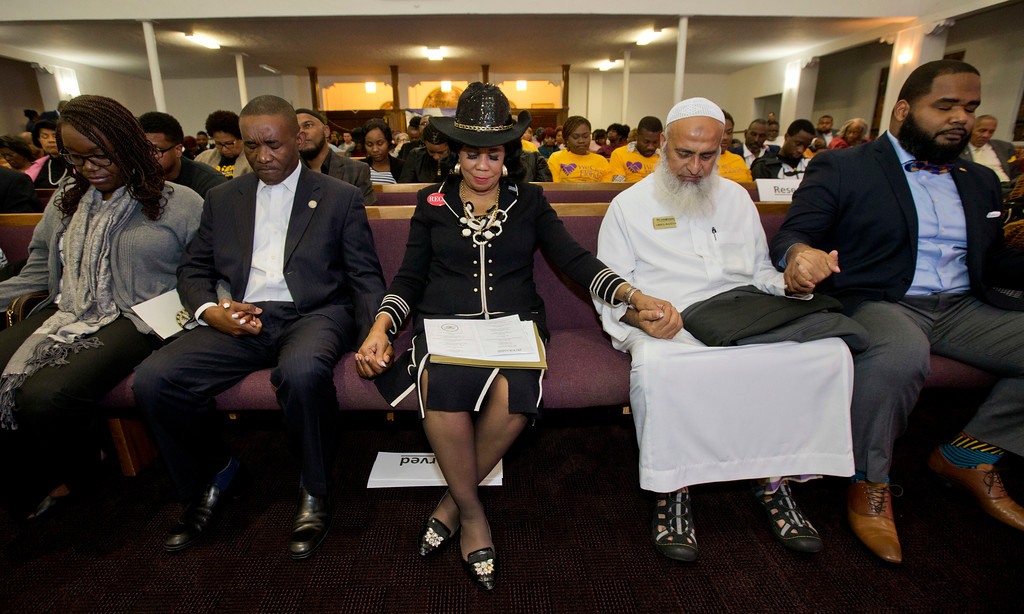 . Rep. Frederica Wilson, D-Fla., center, is joined by Miami-Dade County Commissioner Jean Monestime, left, and businessman Abdul Razzak Khanani, right, during a prayer vigil before watching the President Donald Trump\'s State of the Union at a watch party held at the Historic Greater Bethel AME Church, Tuesday, Jan. 30, 2018, in Miami. (AP Photo/Wilfredo Lee)