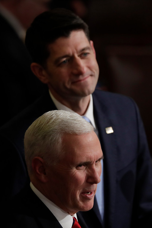 . House Speaker Paul Ryan of Wisconsin and Vice President Mike Pence wait for the arrival of President Donald before the State of the Union address to a joint session of Congress on Capitol Hill in Washington, Tuesday, Jan. 30, 2018. (AP Photo/J. Scott Applewhite)