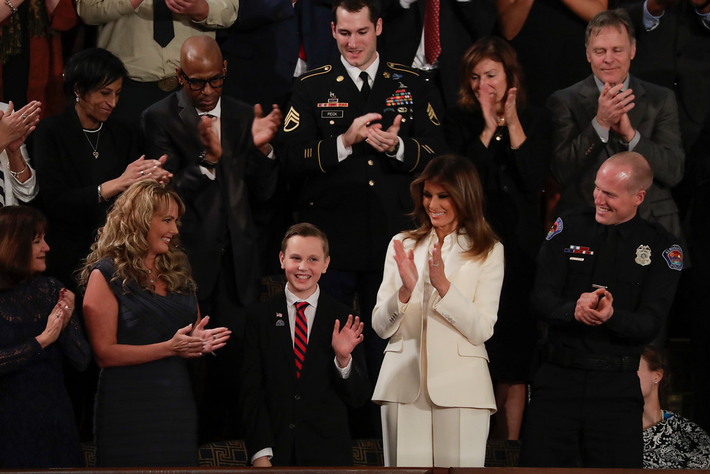 . Preston Sharp waves from the first lady\'s box during the State of the Union address to a joint session of Congress on Capitol Hill in Washington, Tuesday, Jan. 30, 2018. (AP Photo/J. Scott Applewhite)
