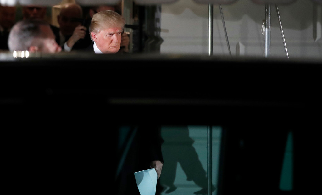 . President Donald Trump walks to his limousine to depart the White House en route to the U.S. Capitol to give the State of the Union Address, Tuesday, Jan. 30, 2018, in Washington. (AP Photo/Alex Brandon)
