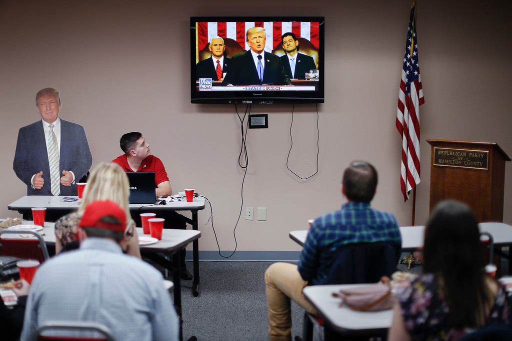 . Supporters watch President Donald Trump speak at a State of the Union watch party hosted by the Hamilton County Republican Party, Tuesday, Jan. 30, 2018, in Cincinnati. (AP Photo/John Minchillo)