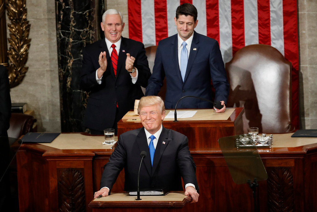 . President Donald Trump steps to the podium to begin his State of the Union address to a joint session of Congress on Capitol Hill in Washington, Tuesday, Jan. 30, 2018. Behind President Trump are Vice President Mike Pence and House Speaker Paul Ryan of Wisconsin. (AP Photo/Pablo Martinez Monsivais)