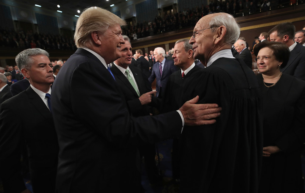 . President Donald Trump greets Supreme Court Associate Justice Stephen Breyer before the State of the Union address in the chamber of the U.S. House of Representatives Tuesday, Jan. 30, 2018, in Washington. (Win McNamee/Pool via AP)