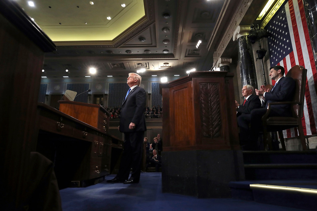 . President Donald Trump prepares to deliver his first State of the Union address in the House chamber of the U.S. Capitol to a joint session of Congress Tuesday, Jan. 30, 2018 in Washington, as Vice President Mike Pence and House Speaker Paul Ryan applaud. (Win McNamee/Pool via AP)