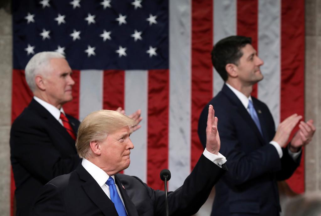 . President Donald Trump waves toward first lady Melania Trump as he delivers his first State of the Union address in the House chamber of the U.S. Capitol to a joint session of Congress Tuesday, Jan. 30, 2018 in Washington, as Vice President Mike Pence and House Speaker Paul Ryan applaud. (Win McNamee/Pool via AP)