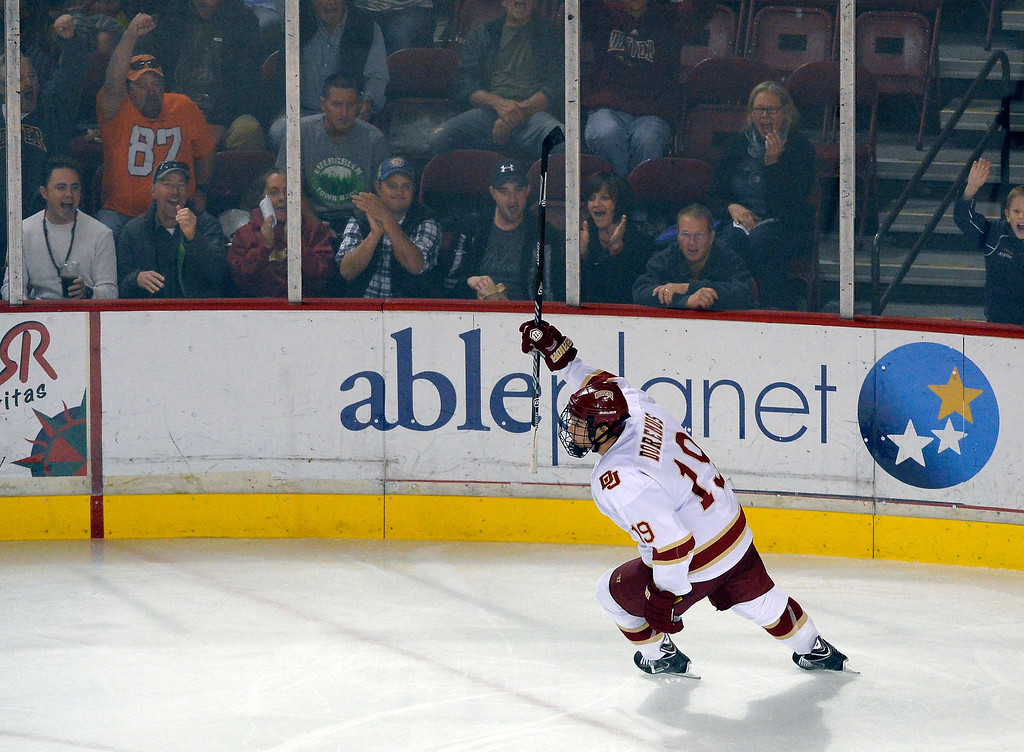 . Denver Pioneers Daniel Doremus (19) celebrates his short handed goal on a back hand shot over University of New Brunswick G Charles Lavigne (31) during the second period October 6, 2013 at Magness Arena. (Photo by John Leyba/The Denver Post)