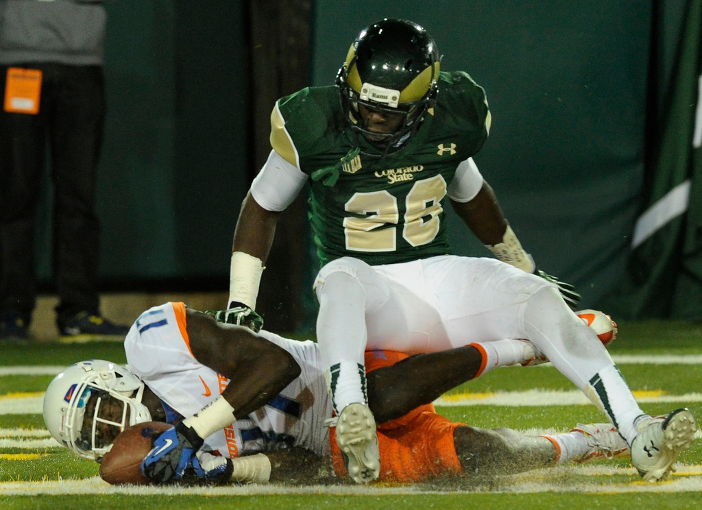 . FORT COLLINS, CO. - NOVEMBER 2: Boise State receiver Geraldo Boldewijn (17) rolled on the ground with a touchdown reception in the second quarter. Because the ball hit the ground the play was reviewed by officials, but it still counted. CSU defender Kevin Pieere-Louis (26) was beat on the play. The Colorado State University football team hosted Boise State Saturday night, November 2, 2013. Photo By Karl Gehring/The Denver Post