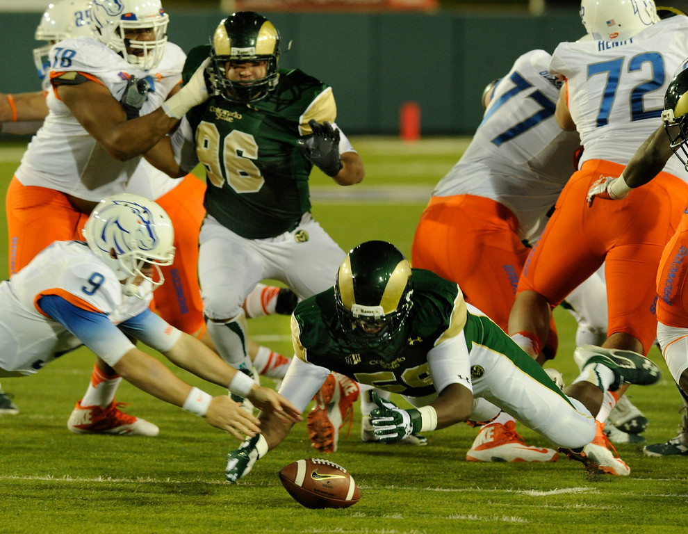 . FORT COLLINS, CO. - NOVEMBER 2: Rams linebacker Shaquil Barett (56) jumped on a fumble after Boise State quarterback Grant Hedrick muffed a handoff on the first Broncos play from scrimmage in the first quarter. The Colorado State University football team hosted Boise State Saturday night, November 2, 2013. Photo By Karl Gehring/The Denver Post