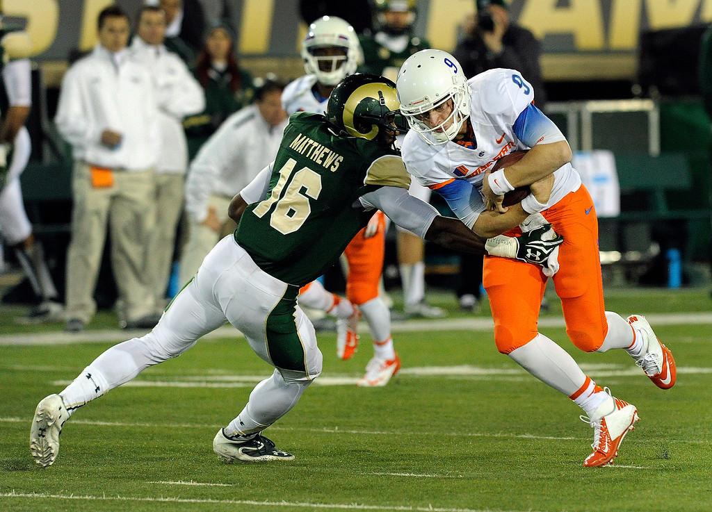 . FORT COLLINS, CO. - NOVEMBER 2: CSU safety Trent Mathews came up stop Broncos quarterback Grant Hedrick on a third quarter scramble. The Colorado State University football team fell to Boise State 42-30 Saturday night, November 2, 2013. Photo By Karl Gehring/The Denver Post