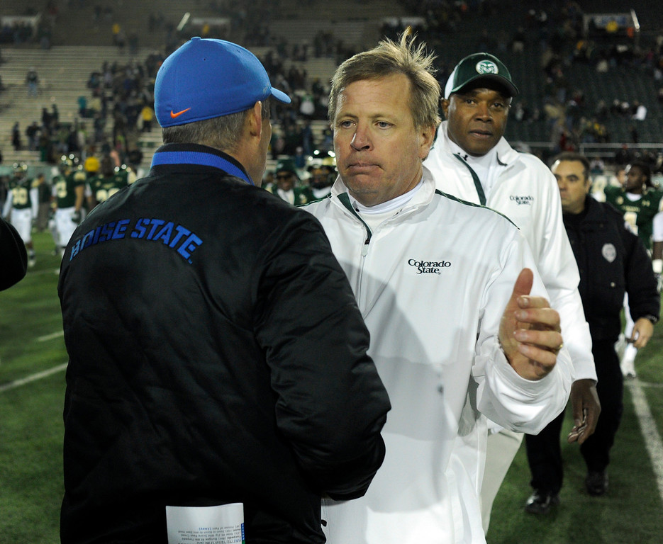 . FORT COLLINS, CO. - NOVEMBER 2: CSU coach Jim McElwain congratulated Chris Petersen after the Broncos\' win. The Colorado State University football team fell to Boise State 42-30 Saturday night, November 2, 2013. Photo By Karl Gehring/The Denver Post