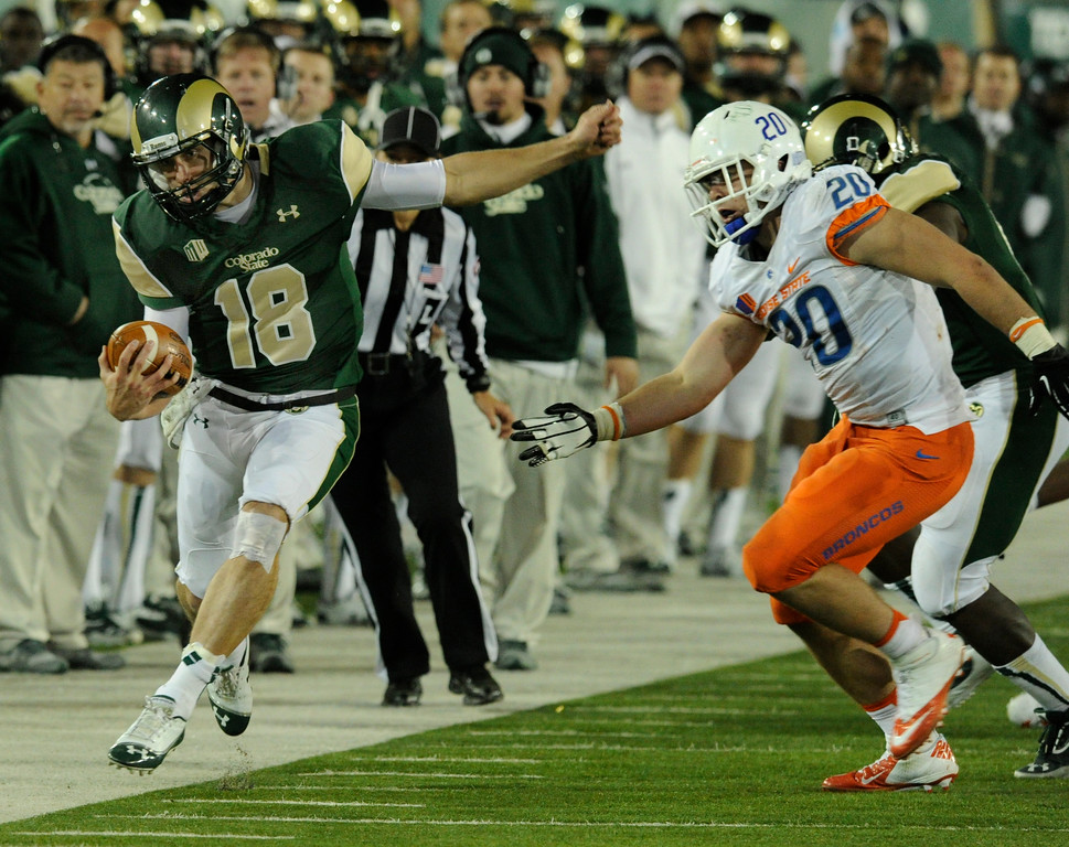 . FORT COLLINS, CO. - NOVEMBER 2: CSU quarterback Garrett Grayson tried to stay in bounds on a broken play in the fourth quarter. The Colorado State University football team fell to Boise State 42-30 Saturday night, November 2, 2013. Photo By Karl Gehring/The Denver Post
