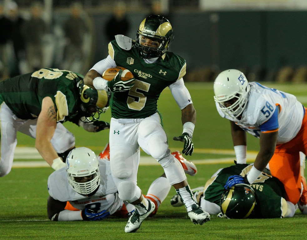 . FORT COLLINS, CO. - NOVEMBER 2: CSU running back Kapri Bibbs (5) made a cut on a first quarter run. The Colorado State University football team hosted Boise State Saturday night, November 2, 2013. Photo By Karl Gehring/The Denver Post