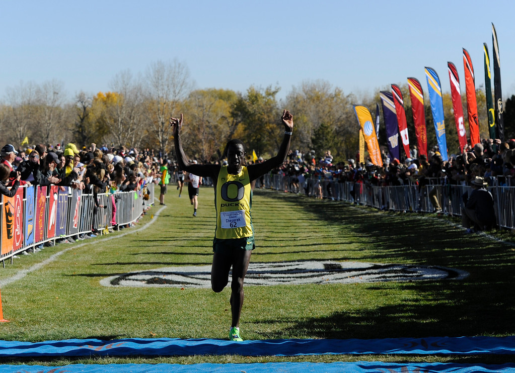 . LOUISVILLE, CO - NOVEMBER 02: Oregon Duck, Edward Cheserek, crosses the finish line in first place to win the Pac 12 Cross Country Championships at the Coal Creek Golf Course Saturday morning, November 02, 2013. (Photo By Andy Cross/The Denver Post)