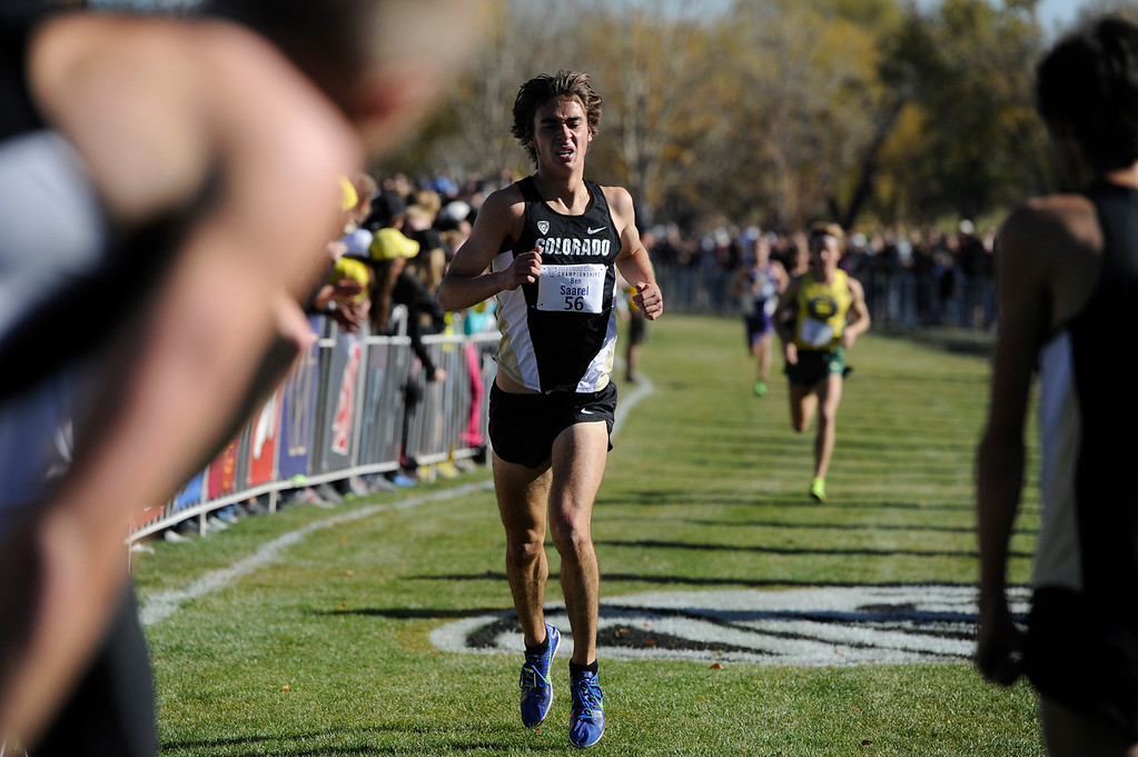 . LOUISVILLE, CO - NOVEMBER 02: Colorado University runner, Ben Saarel, crosses the finish line in 5th place at the Pac 12 Cross Country Championships at the Coal Creek Golf Course Saturday morning, November 02, 2013. CU men won the overall championship. (Photo By Andy Cross/The Denver Post)
