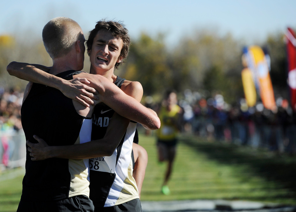 . LOUISVILLE, CO - NOVEMBER 02: Colorado University runners, Connor Winter, left, finished 4th, and Blake Theroux, finished 3rd, embrace at the finish line at the Pac 12 Cross Country Championships at the Coal Creek Golf Course Saturday morning, November 02, 2013. CU men won the overall championship. (Photo By Andy Cross/The Denver Post)