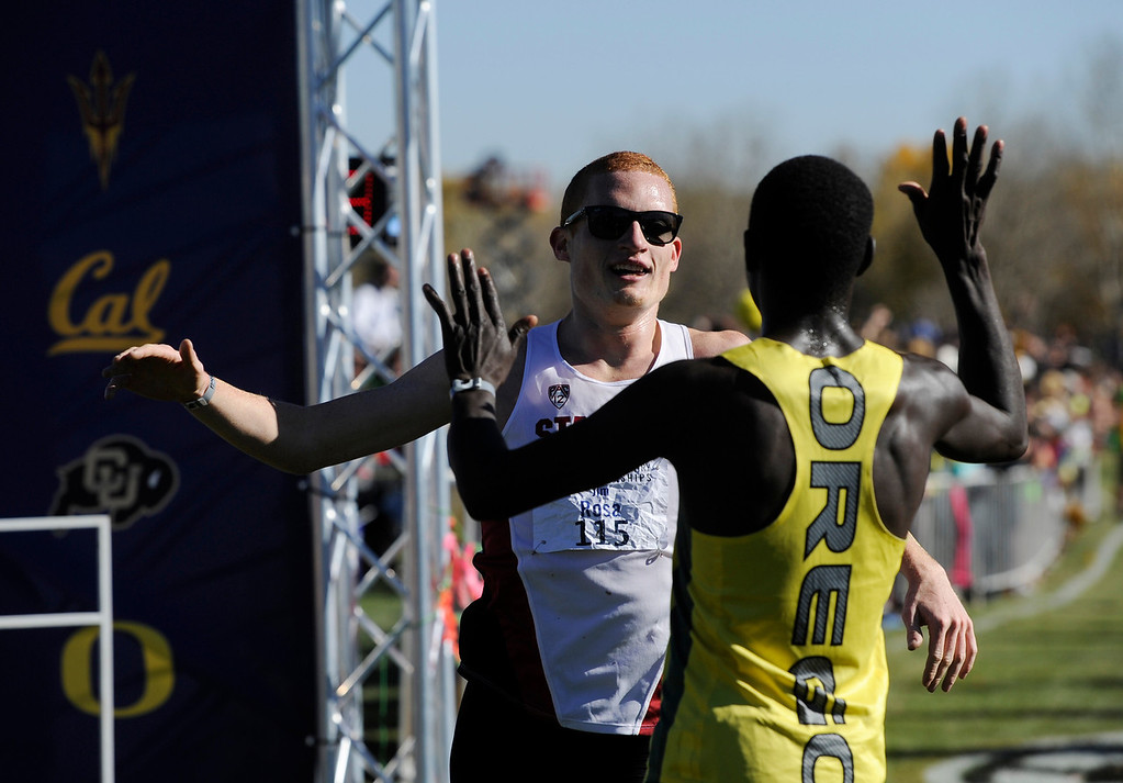 . LOUISVILLE, CO - NOVEMBER 02: Pac 12 Cross Country Championships second place finisher, Jim Rosa, Stanford, left, congratulates winner, Edward Cheserek, Oregon, at the Coal Creek Golf Course Saturday morning, November 02, 2013. (Photo By Andy Cross/The Denver Post)