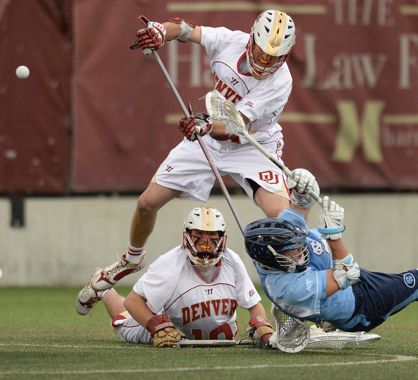 . DENVER, CO - MAY 10:  Tar Heels attack Jimmy Bitter (4) maneuvered past Denver goalie Ryan LaPlante (10) and defender Christian Burgdorf (16) for an attempt in the first half. The University of Denver lacrosse team hosted North Carolina in the first round of the NCAA tournament Saturday night, May 10, 2014.  (Photo by Karl Gehring/The Denver Post)