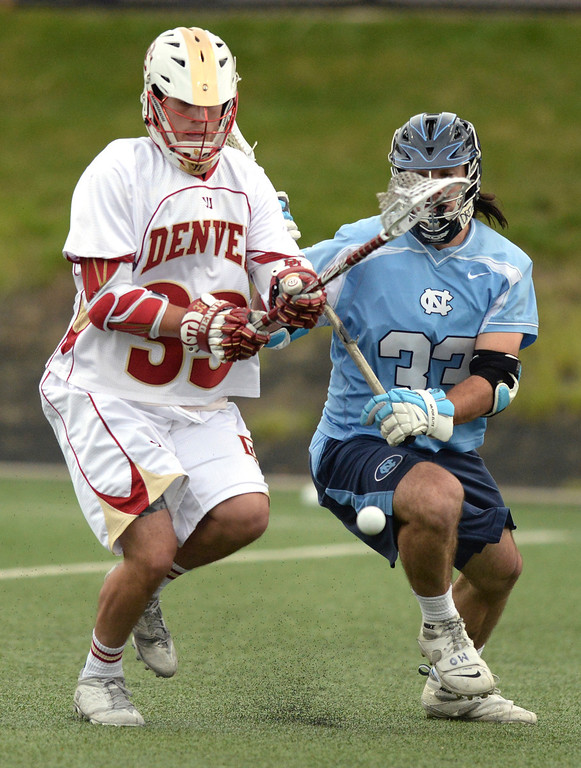 . DENVER, CO - MAY 10:  Denver attack Zach Miller, left, and North Carolina midfielder Ryan Creighton, right, chased a loose ball in the first half. The University of Denver lacrosse team hosted North Carolina in the first round of the NCAA tournament Saturday night, May 10, 2014.  (Photo by Karl Gehring/The Denver Post)