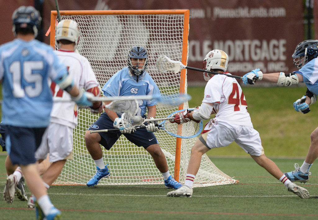 . DENVER, CO - MAY 10:  Denver kiddie Sean Cannizzaro (44) looked for an opening on North Carolina goalie Kieran Burke in the first half. The University of Denver lacrosse team hosted North Carolina in the first round of the NCAA tournament Saturday night, May 10, 2014.  (Photo by Karl Gehring/The Denver Post)