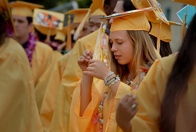 Bale Beck untangles her tassel at Alameda High School's Class of 2016 Commencement Ceremony at Thompson Field in Alameda, Calif., on Friday, June 17, 2016. (Dan Honda/Bay Area News Group)