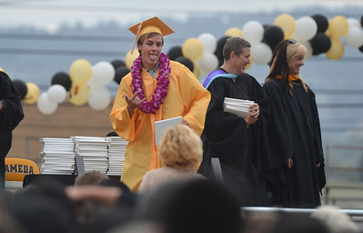 Mitchell Floyd celebrates receiving his diploma at Alameda High School's Class of 2016 Commencement Ceremony at Thompson Field in Alameda, Calif., on Friday, June 17, 2016. (Dan Honda/Bay Area News Group)