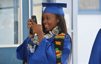 Jada Flucker takes a cell phone photo at the Encinal High School 60th Graduating Class: Class of 2016 Commencement Ceremony at Encinal High School in Alameda, Calif., on Friday, June 17, 2016. (Dan Honda/Bay Area News Group)