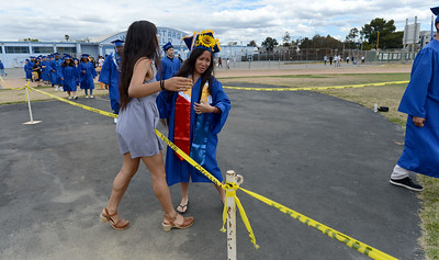 Erin Subido, right, gets a hug from Cristina Rey, left, as she marches into the stadium at the Encinal High School 60th Graduating Class: Class of 2016 Commencement Ceremony at Encinal High School in Alameda, Calif., on Friday, June 17, 2016. (Dan Honda/Bay Area News Group)